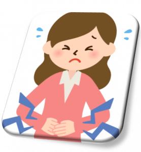腹痛を起こす女性