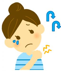 つらい肩こりに泣く女性